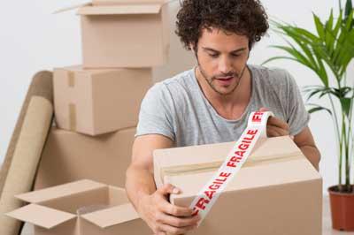 man packing box
