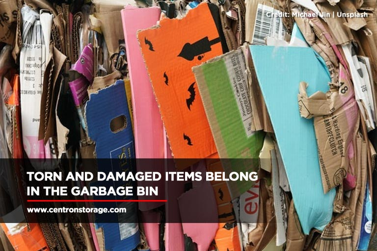 Torn and damaged items belong in the garbage bin